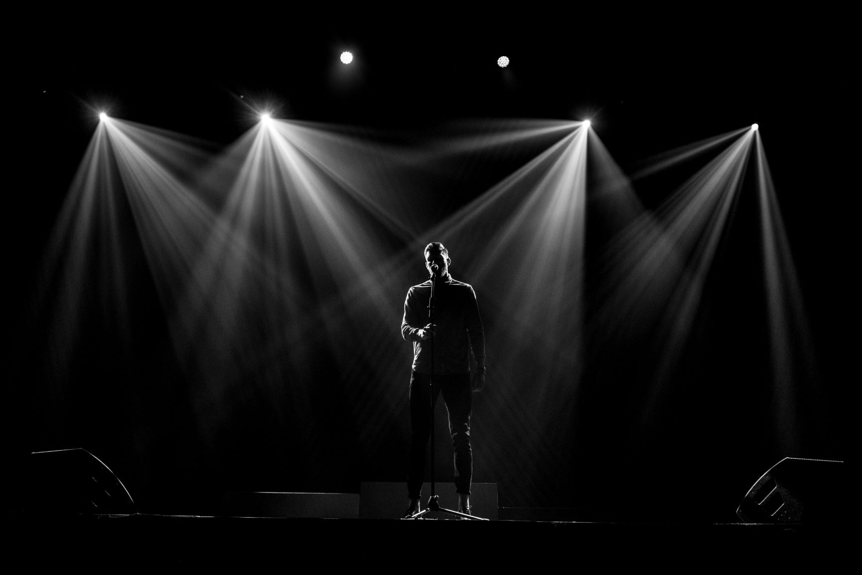 "Chris on stage performing his hit spoken word piece ""Find Your Coast"" in Edmonton, Alberta."